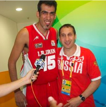 Iranian Olympic basketball player Hamed Ehadadi and the head coach of the Russian team, Israeli David Blatt, embrace in a show of friendship at the recent Olympic games.
