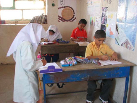 The young Iranian students diligently at work in the smallest school in the world.