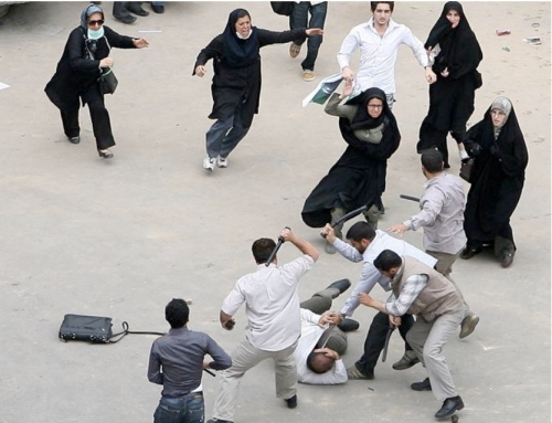 "Let's take a break from the news for the ""Image of the Day"": It was taken yesterday but I missed it. So I share it with you today. Several women fearlessly coming to the aid of a man being beat by the security forces."