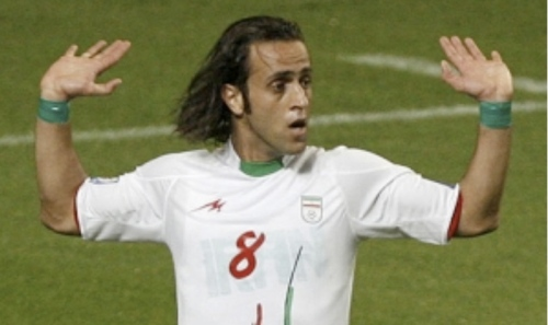 Iranian soccer player Ali Karimi proudly showing his green bands in support of Mousavi during the World Cup qualifying match.