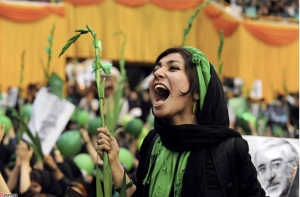 An Iranian woman cheers loudly for Mousavi at his last rally.