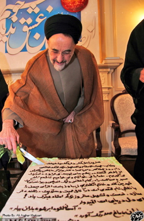 Khatami on his birthday with his giant birthday cake.