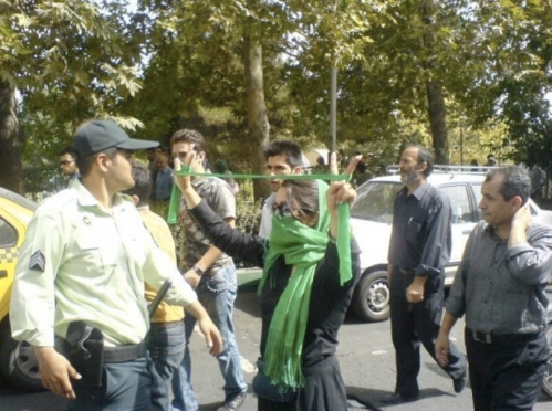 "A photo of one of the courageous women defiling the governments orders and proudly demonstrating in favor of the Green Movement during the November 4th ""Quds Day"" protests."